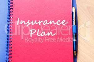 Insurance plan write on notebook