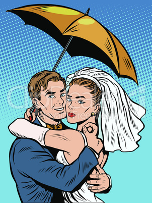 Couple in love bride and groom under an umbrella