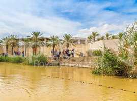 Tourists near Jordan River, at the site of Jesus' baptism