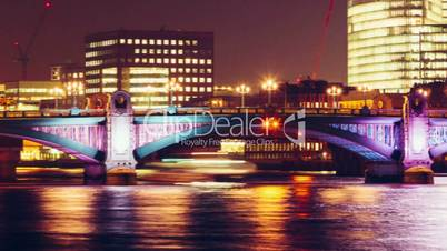 The Shard and Southwark Bridge in London, UK by night
