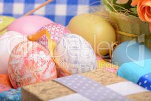 Arrangement of Gift Boxes in Wrapping Paper with Checkered Ribbons and Decorated Easter Eggs isolated on white background