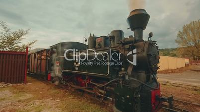 Industrial Steam Freight Train in a Small Rural Village - Wide Angle View