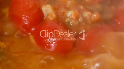Pan with Boiling Red Peppers Stuffed with Rice and Minced Meat - Ultra Macro Shot