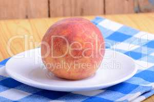 fresh peach on white plate