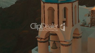 Establishing Ultra Close-up Shot of a Traditional Blue Dome Cycladic Church and the Aegean Sea