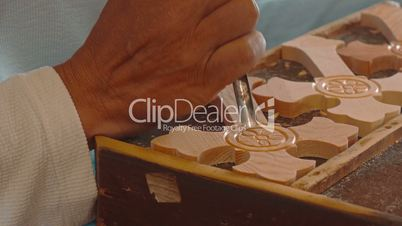 Craftsman Chiselling a Wooden Cross - Ultra Close-up