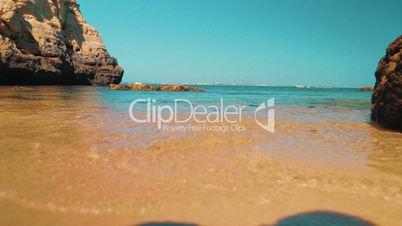 Slider Low Angle Beach Shore Shot in the Algarve, Portugal
