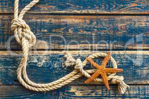 Sea background with starfish and marine rope