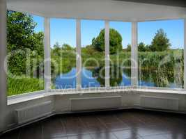 modern window with view of summer lake