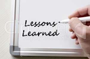 Lessons learned written on whiteboard