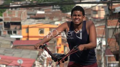 Man Walking Bicycle In Poor Country