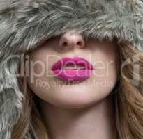 lips of the woman wearing hat