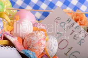 hand made eggs at a gift box, happy easter invitation card