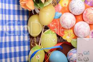 Happy Easter invitation card, hand made eggs at a gift box