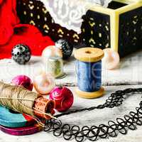Jewelry and a sewing tool