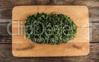 parsley and dill on chopping board