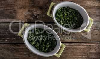 parsley on wood in the dish