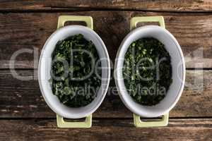 parsley in dish on wood