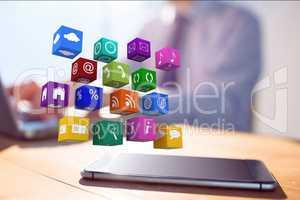 Apps hovering over tablet pc on desk