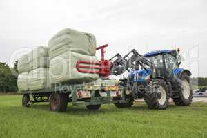 Agriculture loading of plastic hay bales.