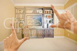 Hands Framing Drawing of Entertainment Unit Gradating Into Photo