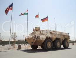 german armored ambulance vehicle  fuchs  in front of national flags