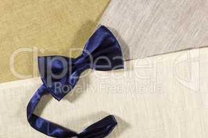 Bow tie on a linen napkin