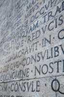 Latin inscription on wall in Rome, Italy