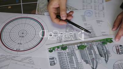 building, business, architecture, construction and people concept - close up of male hand with blueprint and pencil