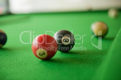 Billard balls on green billard table