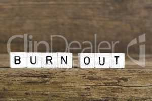 The words burn out written in cubes