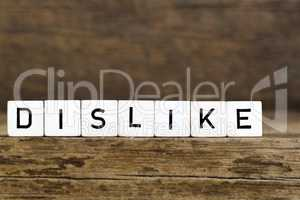 The word dislike written in cubes