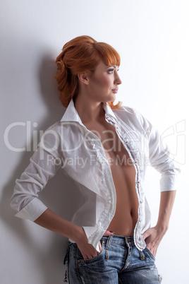 Portrait of seductive young model posing in studio