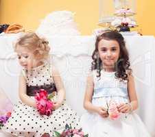 Image of beautiful girls dressed in lush dresses