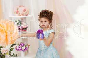 Pretty girl posing with gift in vintage interior