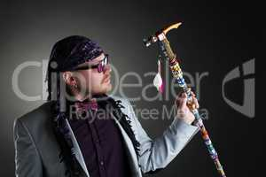 Shot of middle-aged man posing with decorated cane
