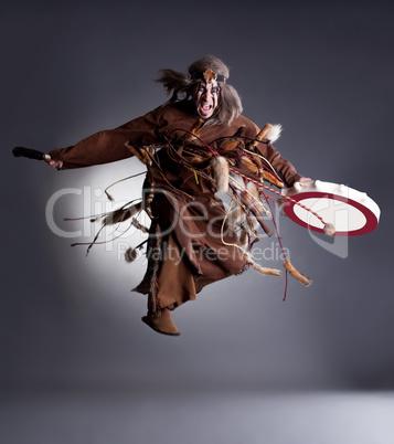Studio shot of angry shaman posing in jump