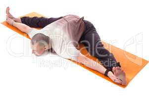 Shot of middle aged man practicing yoga on mat