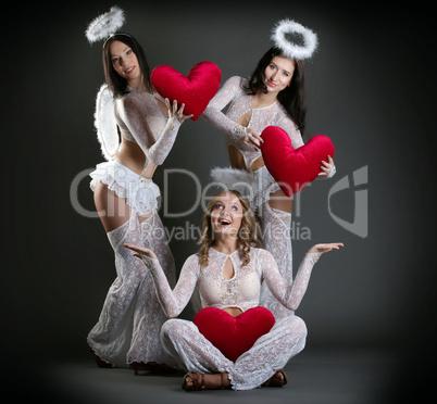 Studio shot of beautiful girls posing as cupids