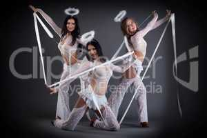 Image of sexy dancers in costumes with halos