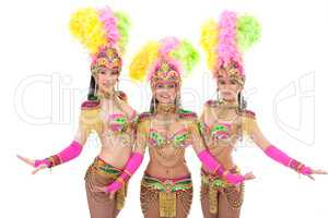 Cute girls posing in colorful carnival costumes