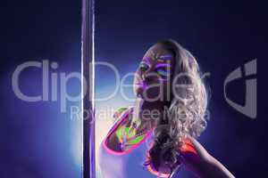 Portrait of alluring pole dancer with neon makeup