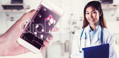 Composite image of asian doctor holding blue binder