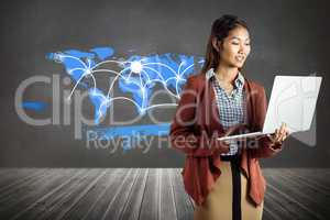 Composite image of smiling businesswoman using laptop