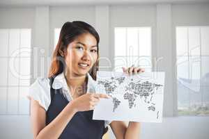 Composite image of smiling businesswoman pointing a sheet of pap