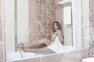 Image of shy sexy woman have caught in shower