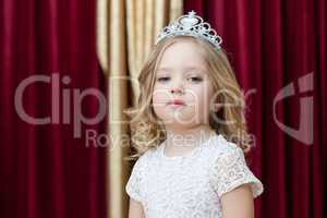 Majestic girl posing in smart dress and tiara
