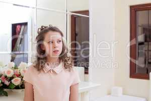 Pensive fair-haired girl looking away from camera