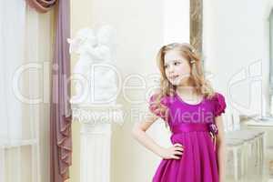 Smiling blonde model posing in magenta dress