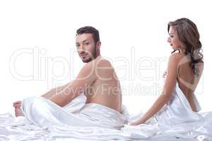 Attractive sexual partners posing in bed